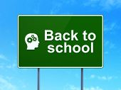 Education concept: Back to School and Head With Gears on road sign background
