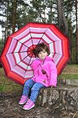 Little Girl In The Forest With An Umbrella.