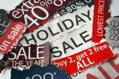 Various holiday on sale signs from the newspapers