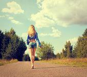 stock photo of girl walking away  - Full Length Photo of Sexy Blonde Woman Walking Away - JPG