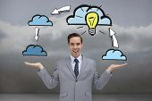 Smiling businessman presenting graphics with his hands against clouds in a room