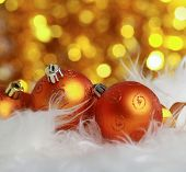 golden christmas ball on a furry background, christmas balls