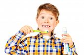 image of toothless smile  - Little funny boy smiling and brushing his teeth - JPG