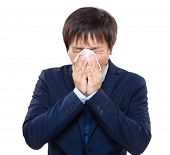 Businessman with allergy sneezing