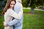 pic of sweethearts  - Happy girl embracing her boyfriend in park - JPG