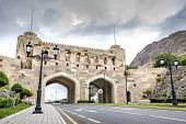 stock photo of oman  - City gate in Muscat Oman on a cloudy day - JPG
