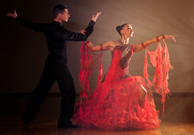 foto of waltzing  - Professional ballroom dance couple preform an romantic exhibition dance - JPG