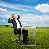 pic of fatigue  - fatigued businessman yawning and stretching oneself - JPG