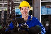 picture of blue-collar-worker  - happy blue collar worker with tools in workshop - JPG