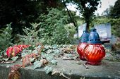 pic of burial-vault  - Grave in twitlight with ivy and red icon lamp