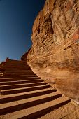 stock photo of camel-cart  - Steep steps carved in the multicoloured rock face in the archaeological site of Petra Jordan - JPG