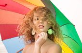 stock photo of naturist  - Young beautiful girl with a colorful umbrella - JPG