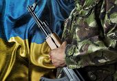 foto of arsenal  - Ukraine waving flag with soldier - JPG