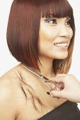 stock photo of pacific islander ethnicity  - Pacific Islander woman having haircut - JPG
