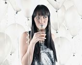 stock photo of pacific islander ethnicity  - Pacific Islander woman drinking champagne - JPG