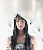 stock photo of pacific islander ethnicity  - Pacific Islander woman holding balloons - JPG