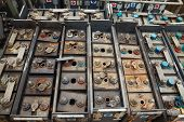 stock photo of tram  - Old batteries of a tram rusting in werehouse - JPG
