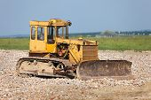 picture of dozer  - Old dozer at a construction site - JPG