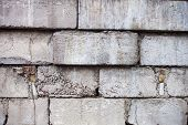 stock photo of mortar-joint  - Grey wall constructed of the concrete blocks - JPG