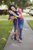 image of pre-adolescents  - Hispanic grandmother and granddaughter hugging - JPG