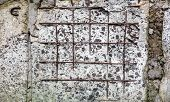 image of mortar-joint  - Grey concrete surface with visible blocks joints and reinforcement bars - JPG