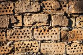 stock photo of mortar-joint  - The old brick wall with rich texture - JPG