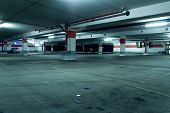 image of parking lot  - One car in dirty underground parking garage of shopping center - JPG