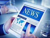 picture of economics  - Hands Holding Digital Tablet Global Economics News - JPG
