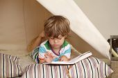 stock photo of teepee  - Child playing at home indoors with a teepee tent - JPG