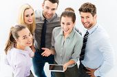 picture of fellowship  - Business people with digital tablet - JPG