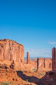 picture of southwest  - Vertical American Southwest desert landscape of red rock sandstone formations against deep blue sky in canyon in Utah
