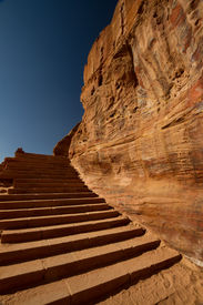picture of camel-cart  - Steep steps carved in the multicoloured rock face in the archaeological site of Petra Jordan - JPG