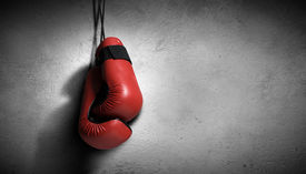 stock photo of knockout  - Pair of red boxing gloves hanging on wall - JPG
