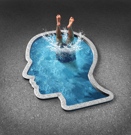 stock photo of emotion  - Deep thinking and soul searching concept with a person diving into a swimming pool shaped as a human face as a symbol of self examination and mental health issues related to inner feelings and emotions - JPG