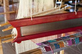 pic of handloom  - Vintage manual weaving loom with unfinished textile work - JPG