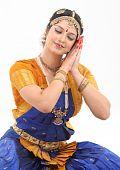 stock photo of bharatanatyam  - Woman doing the posture of sleeping in dance - JPG