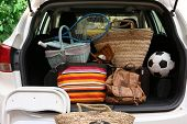 image of heavy bag  - Suitcases and bags in trunk of car ready to depart for holidays - JPG