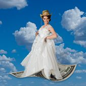 image of cowgirl  - Cowgirl flying magic carpet money - JPG
