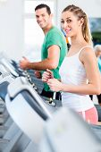stock photo of treadmill  - Couple on treadmill in fitness gym running for sport - JPG