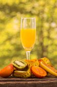 image of banana tree  - glass of juice with slices of kiwi - JPG