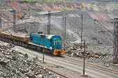pic of iron ore  - Cargo train carrying iron ore on the opencast mining quarry - JPG