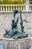 stock photo of metal sculpture  - Young lady near tree sculpture in Moscow Russia - JPG