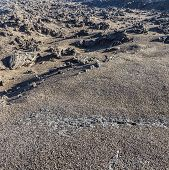 pic of volcanic  - volcanic stone formations in Timanfaya National Park in Lanzarote Spain with cracked rocks - JPG