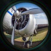 stock photo of propeller plane  - Old airplane engine with propeller in objective lens - JPG