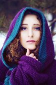 picture of auburn  - Mysterious young woman in purple knitted cape with a hood in winter forest - JPG