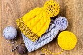 stock photo of ball cap  - ball of threads and knitting caps on wooden background - JPG
