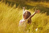 image of rapture  - Little girl in a state of rapture - JPG