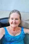 pic of hot-tub  - Mature female blond beauty relaxing in her hot tub outdoors - JPG