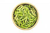 foto of sweet pea  - fresh sweet vegetable pea pods in wicker basket isoalted on white - JPG