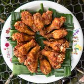 picture of southern fried chicken  - Homemade fried chicken drumsticks cooking with original thai style and serve on Weaved pandan - JPG